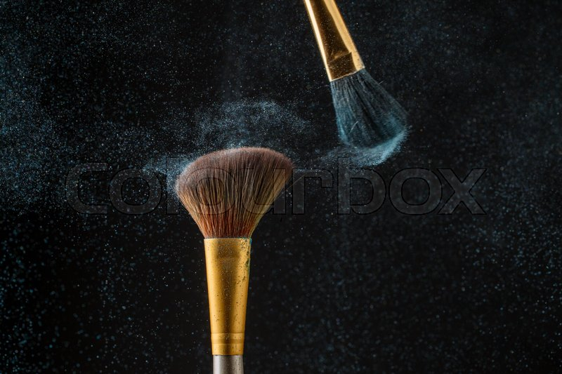 Art of visage. Brush and a powder spread. Background with copy place, stock photo