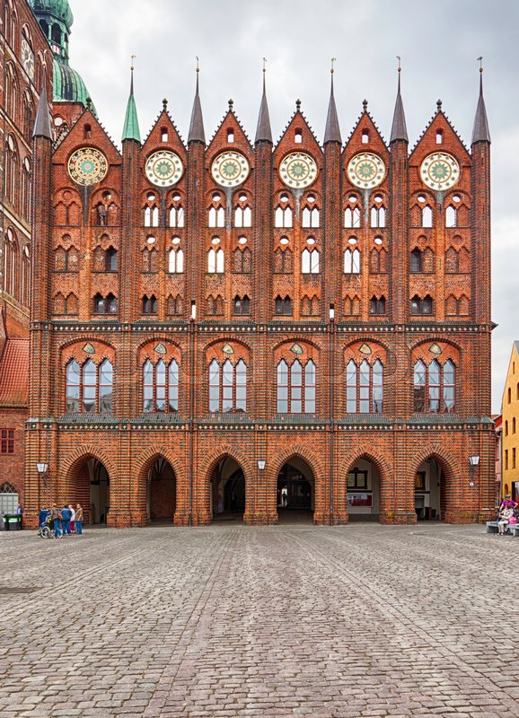Stock image of 'Stralsund, Germany - September 23, 2016: UNESCO world heritage site Stralsund town hall. The facade of the brick-gothic building was built in 14th century.'