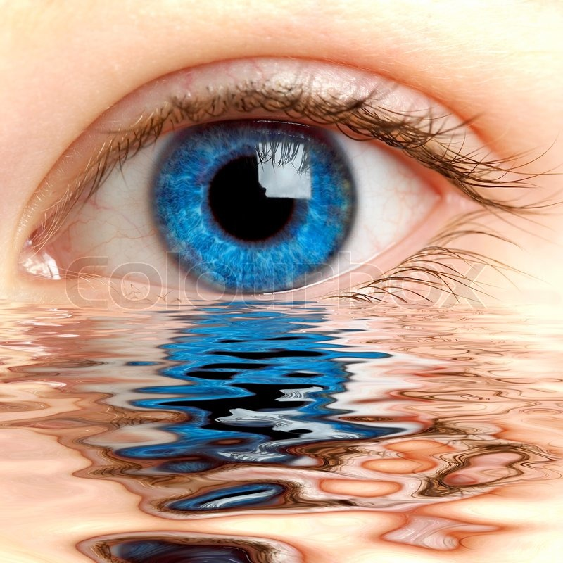 Human eye reflected in a surface of water | Stock Photo | Colourbox