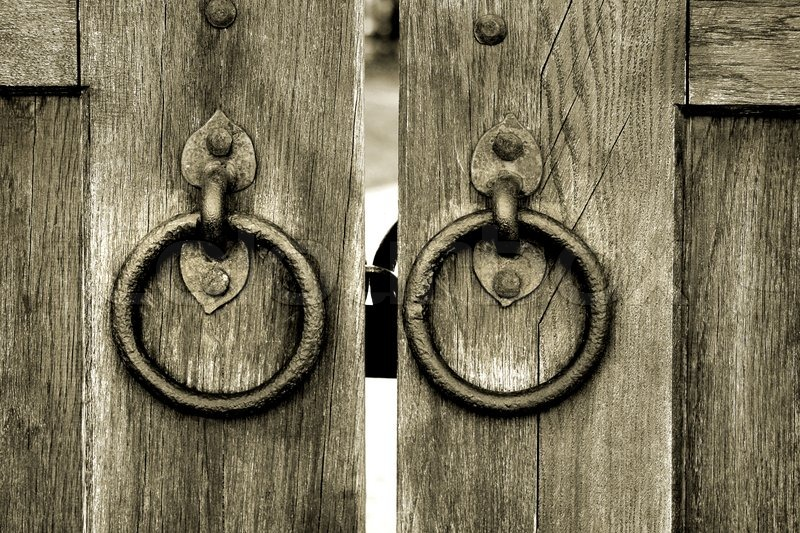 Ancient Wooden Gate With Two Door Knocker Rings Close Up