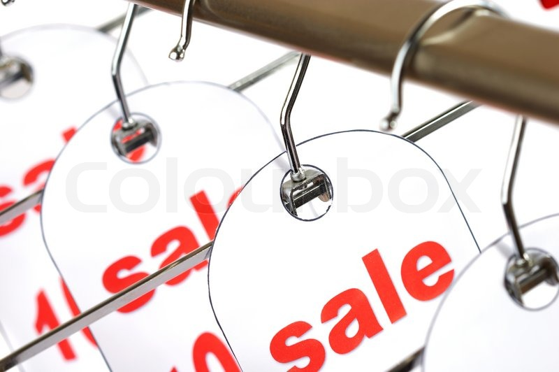 sale a hanger with labels on a white background stock photo
