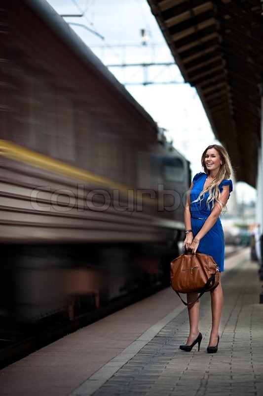 Attractive Lady Waiting Train On The Platform Of Railway