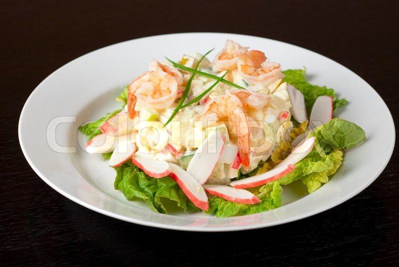 Salad of shrimps, crab meat, cucumbers, apples, potatoes, lettuce ...