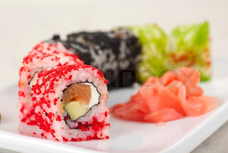 Sushi rolls made of fish avocado and different flying fish roe ...