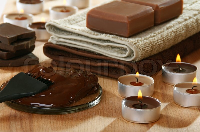 Sensuality spa chocolate aromatherapy items on a wooden ...