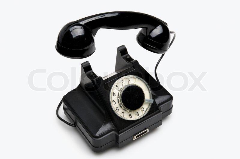 old black vintage dreh stil telefon ber einen wei en hintergrund isoliert stockfoto colourbox. Black Bedroom Furniture Sets. Home Design Ideas