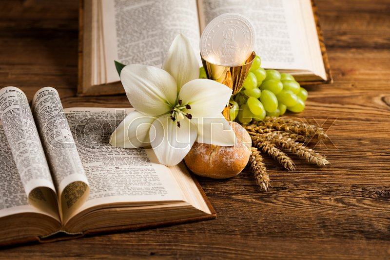 Symbol christianity religion a golden chalice with grapes and bread wafers, stock photo