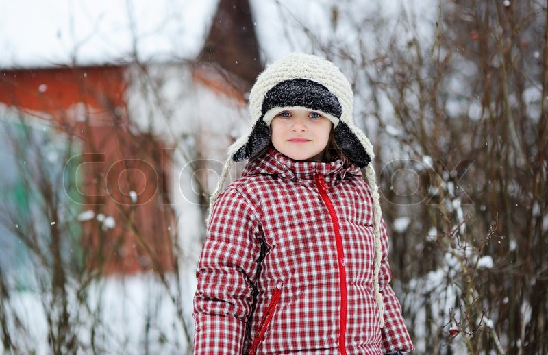 48b770423bb6 Adorable child girl wearing warm white hat and red coat