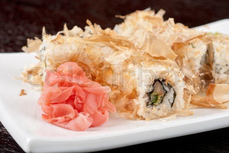 Sushi rolls of rice, nori, cream cheese, avocado, smoked ...