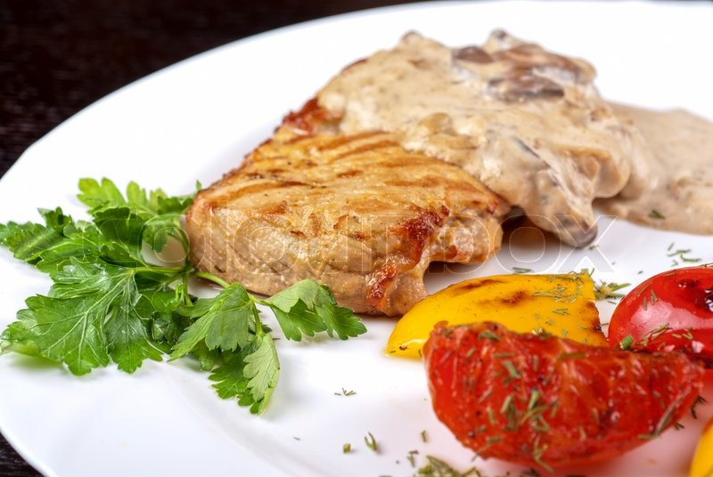 Pork steak with mushroom sauce and grilled vegetables | Stock Photo ...