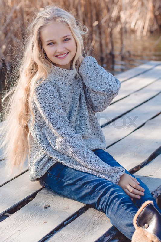 Little Cute Smiling Girl With Long Stock Photo