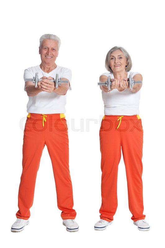 Stock image of 'Portrait of Senior Couple Exercising On White Background'