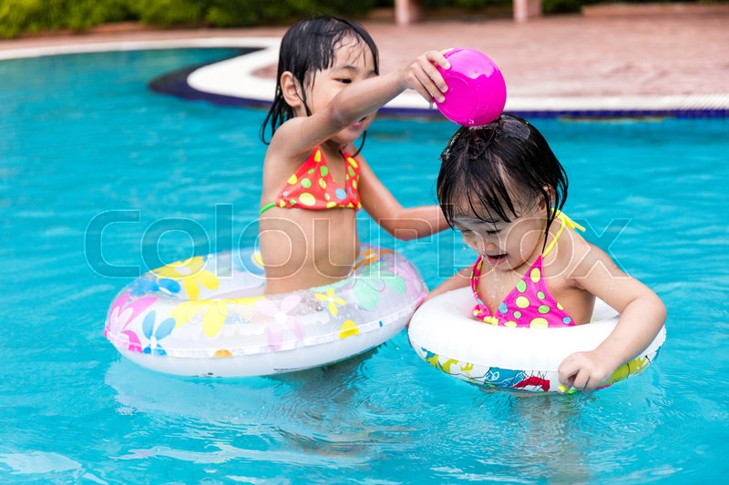 Stock image of 'Asian Chinese Little Girls Playing in the Outdoor Swimming Pool'