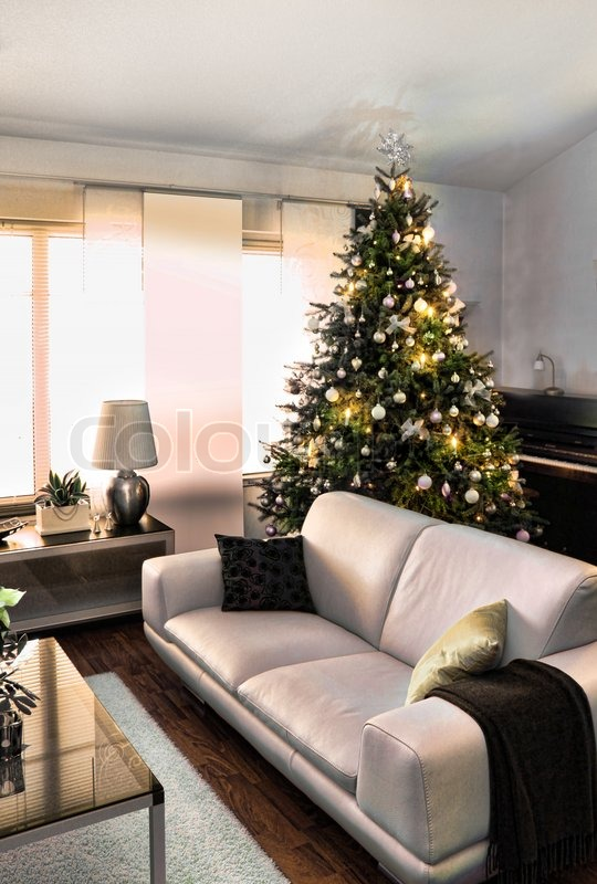 Christmas Tree In Living Room christmas tree in modern furniture home living room | stock photo