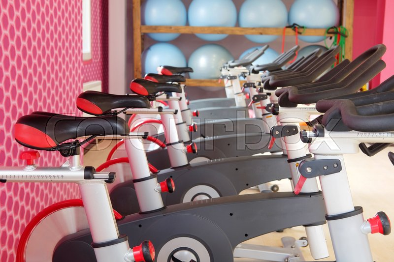 Stock image of 'Fitness hall with sport bicycles'
