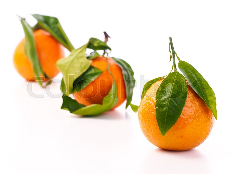 Stock image of 'Oranges with leaves'