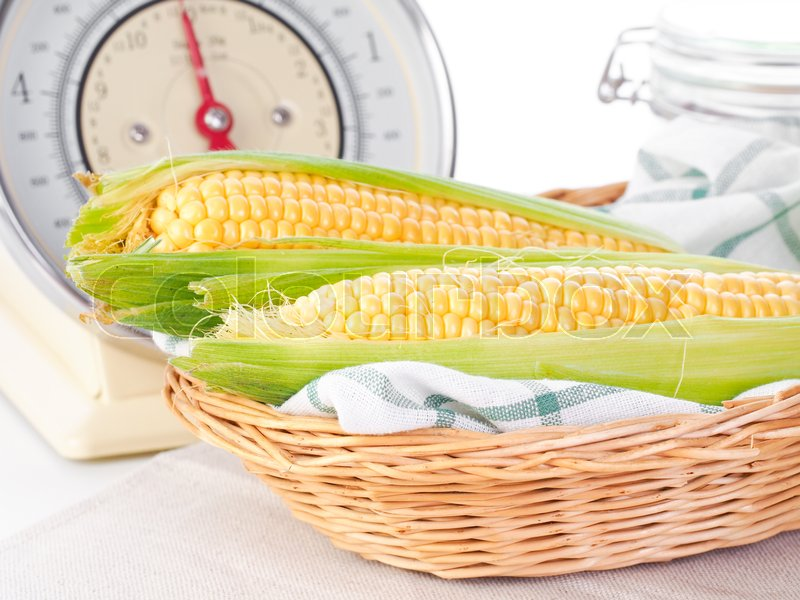 Stock image of 'Corn cobs in a basket'