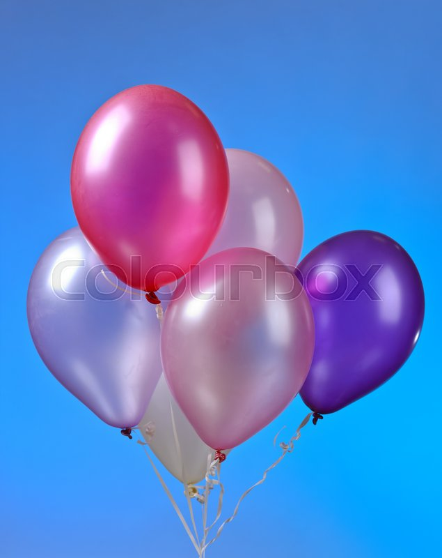 Stock image of 'A bunch of colored balloons on a blue background'