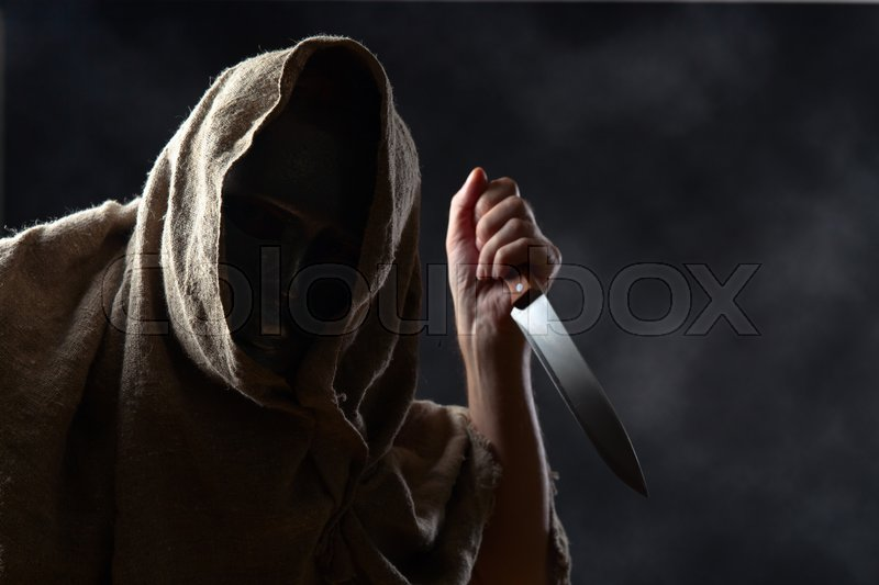 Stock image of 'The hooded man in mask with a big knife'