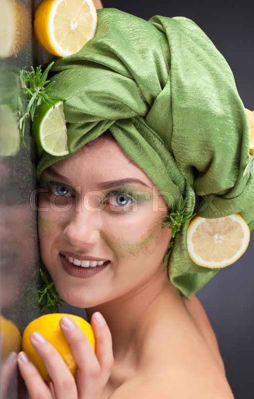 Stock image of 'Woman with lemon , lime and  rosemary'
