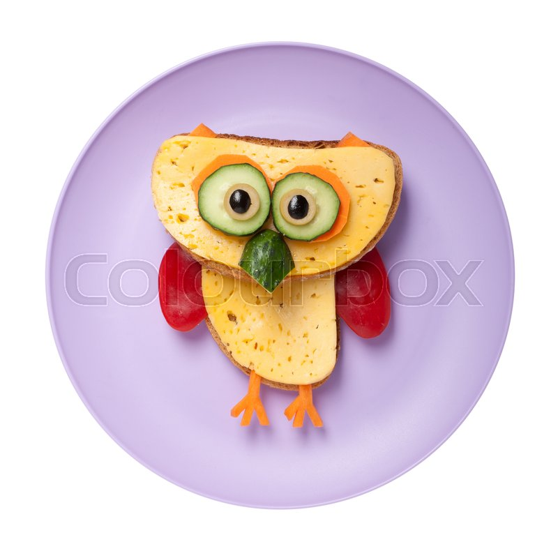 Stock image of 'Owl made of cheese and bread on plate'