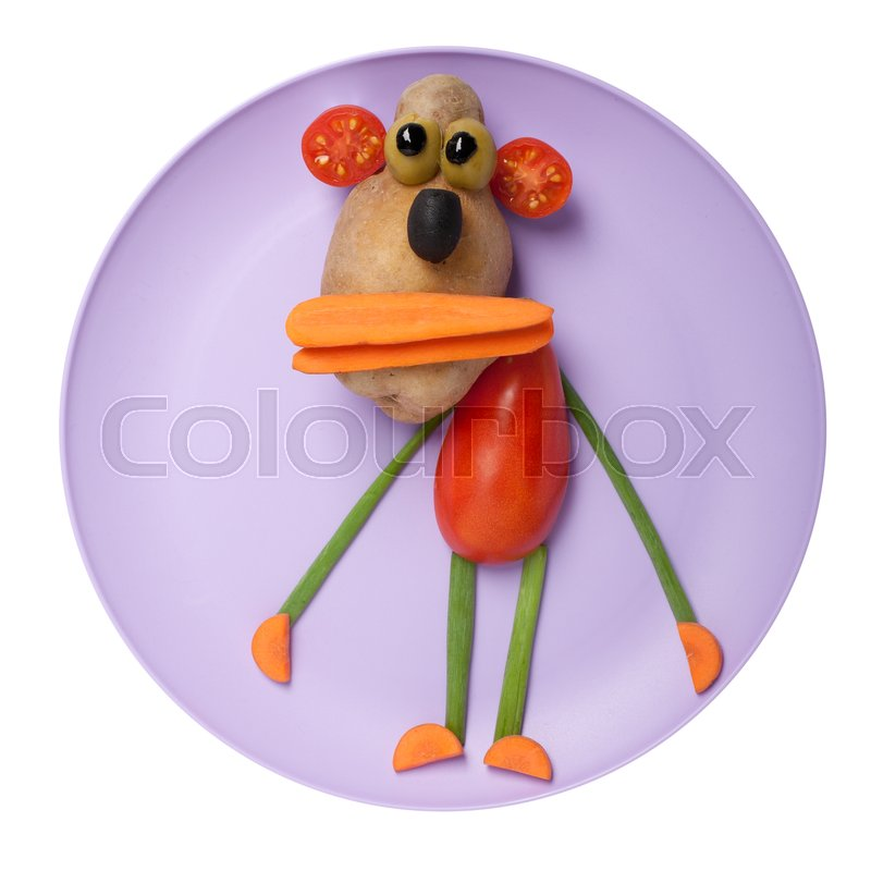 Stock image of 'Monkey made of vegetables on purple plate'