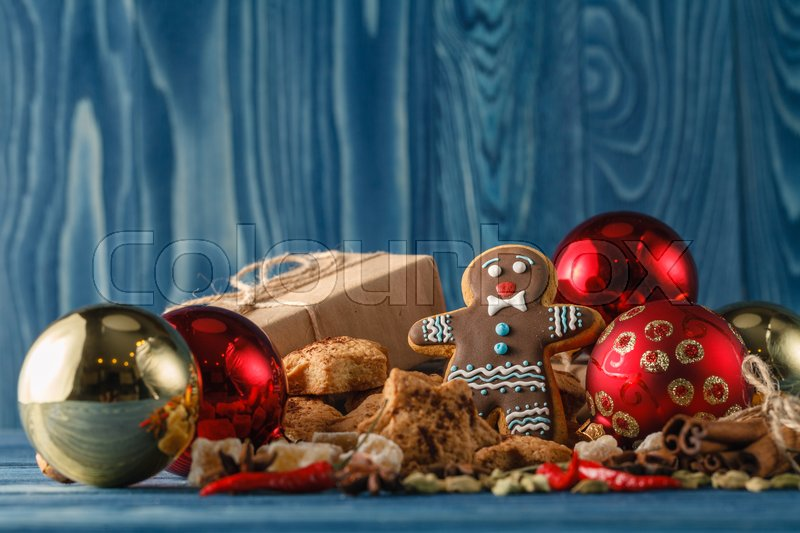 Stock image of 'Christmas butter and chocolate cookies with festive decoration on white wooden background, selective focus. Edible gift'