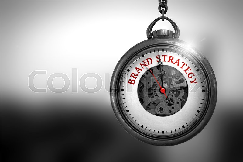 Stock image of 'Business Concept: Brand Strategy on Vintage Pocket Clock Face with Close View of Watch Mechanism. Vintage Effect. Brand Strategy Close Up of Red Text on the Watch Face. 3D Rendering.'