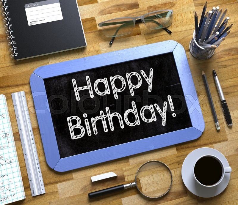 Stock image of 'Happy Birthday Handwritten on Blue Small Chalkboard. Top View of Wooden Office Desk with a Lot of Business and Office Supplies on It. Happy Birthday - Text on Small Chalkboard.3d Rendering.'