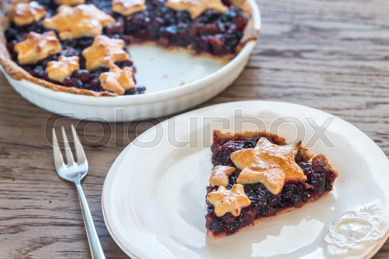 Stock image of 'Portion of mince pie on the wooden background'