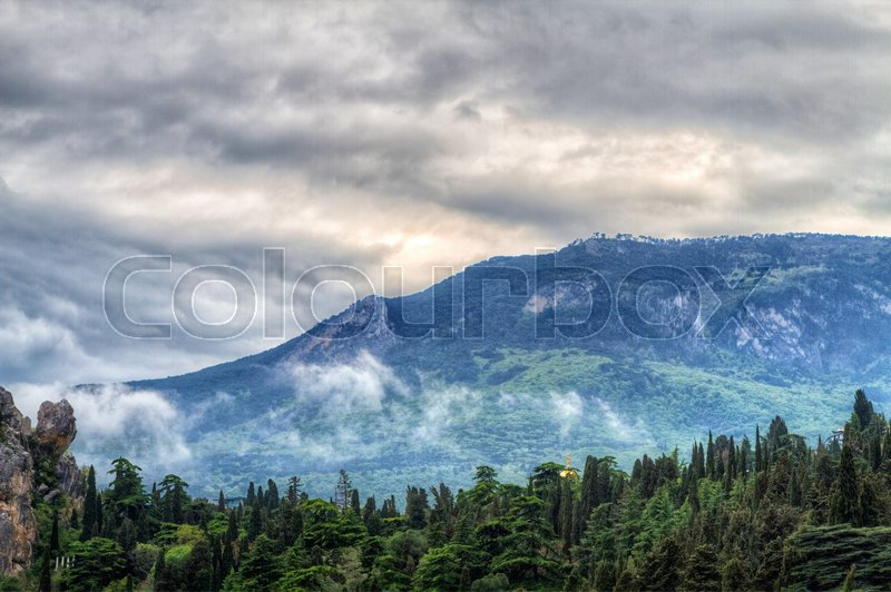 Stock image of 'Hurzuf or Gurzuf is a resort-town in the Crimea (northern coast of the Black Sea). The famous mount of Ayu-Dag (Bear Mountain) is in the background.'