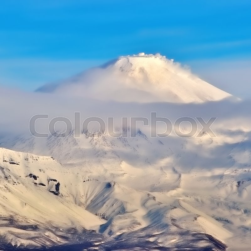 Stock image of 'Volcano with snow in winter day in Russia on Kamchatka'