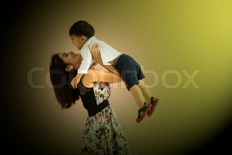 Stock image of 'Happy family mother and baby son playing and having fun'