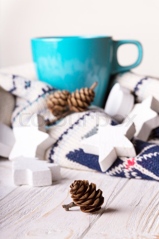 Stock image of 'cup of coffee and Christmas decorations and bumps in the foreground\'