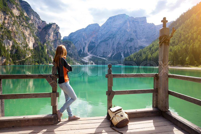 Stock image of 'girl and view of well-known tyrolean lake lago di Braies Dolomites Italy\'