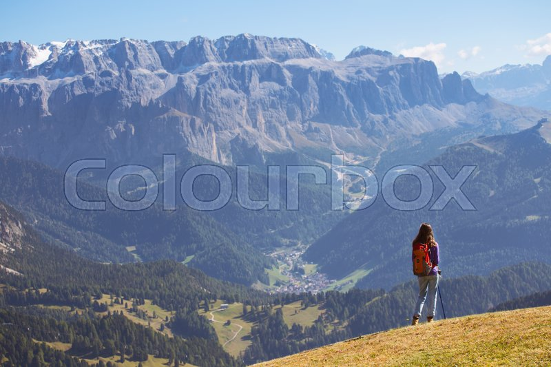 Stock image of 'girl hiker at the mountains Dolomites and views of the valley, Italy. Seceda\'