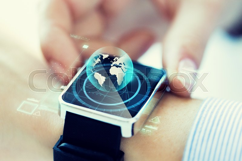Stock image of 'business, technology, communication, connection and people concept - close up of woman hands globe hologram on smartwatch'