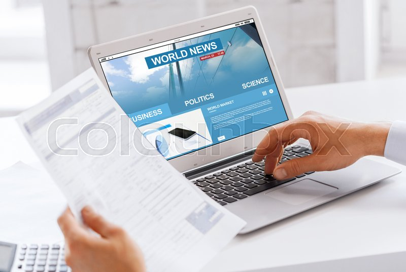 Stock image of 'business, technology, mass media and people concept - close up of businessman with internet news on laptop computer screen working at office'