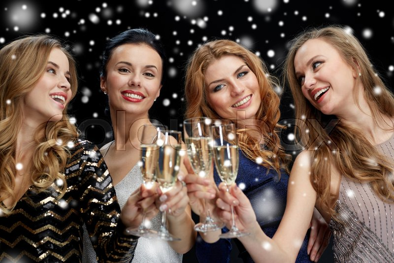 Stock image of 'celebration, friends, new year, christmas and winter holidays concept - happy women with champagne glasses at bachelorette party at night club over snow'