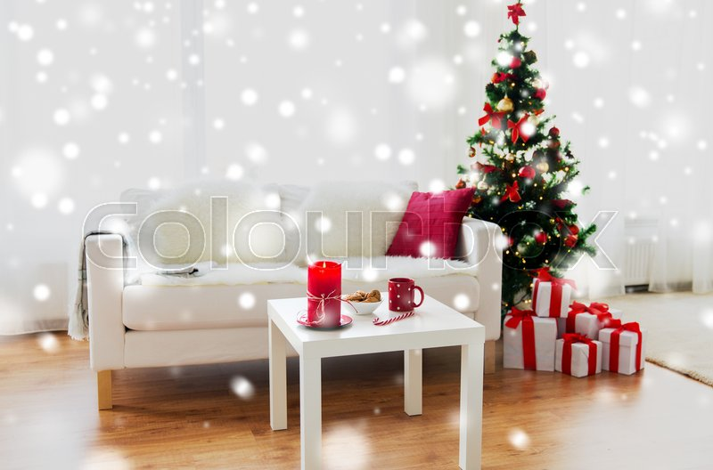 Stock image of 'christmas, holidays, winter, home and still life concept - living room interior with christmas tree and gifts'