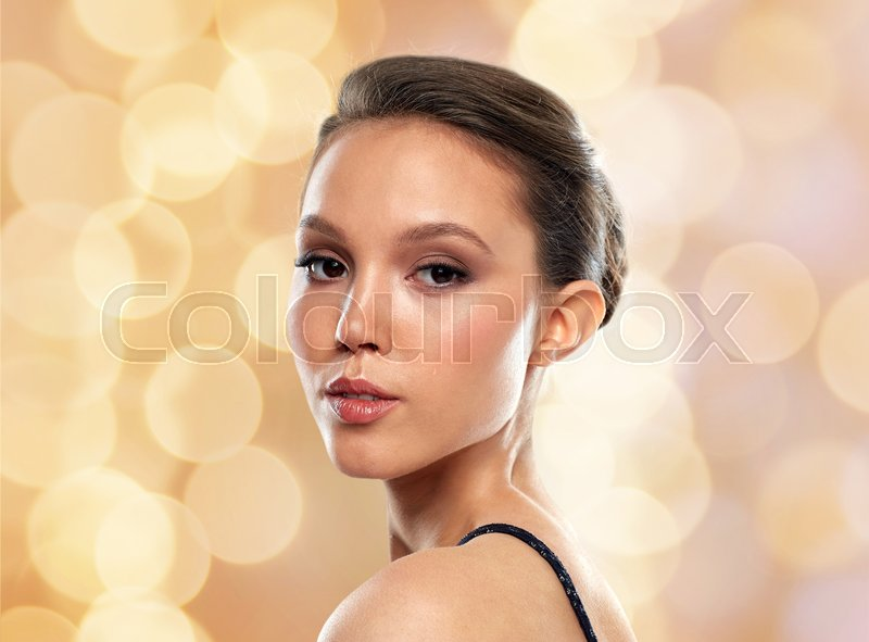 Stock image of 'beauty, people and luxury concept - beautiful young asian woman over holidays lights background'