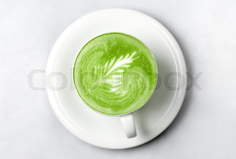 Stock image of 'drink, diet, weight-loss and slimming concept - cup of matcha green tea latte over white'