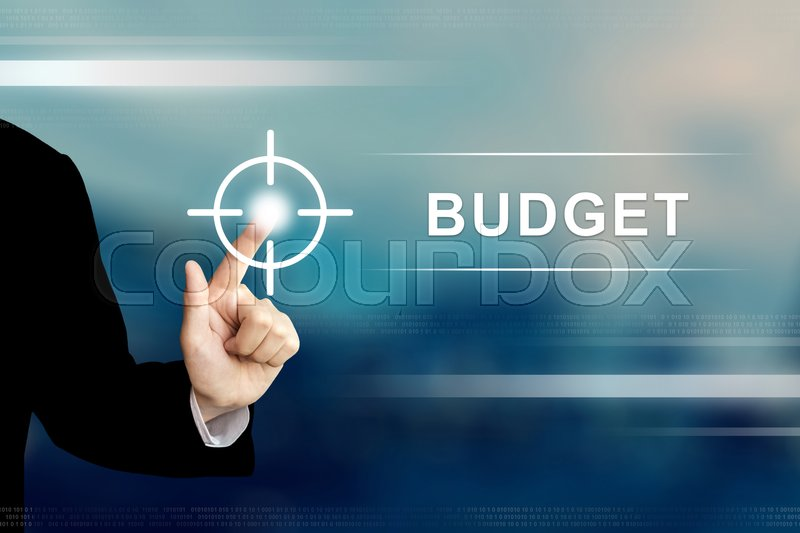 Stock image of 'business hand pushing budget button on a touch screen interface'