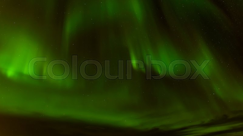Stock image of 'A beautiful green Aurora borealis or northern lights at Tromso, Norway'