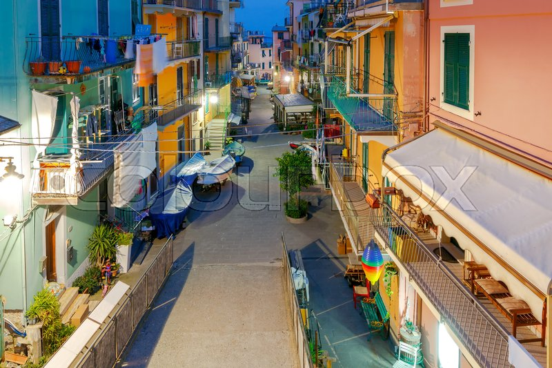 Stock image of 'The old, narrow street in the medieval Italian village of Manarola at night. Parco Nazionale delle Cinque Terre, Liguria, Italy.'