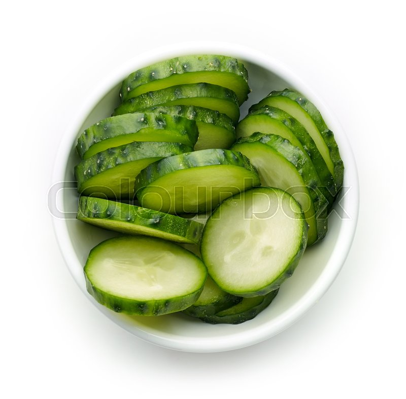 Stock image of 'Bowl of fresh cucumber slices, from above'