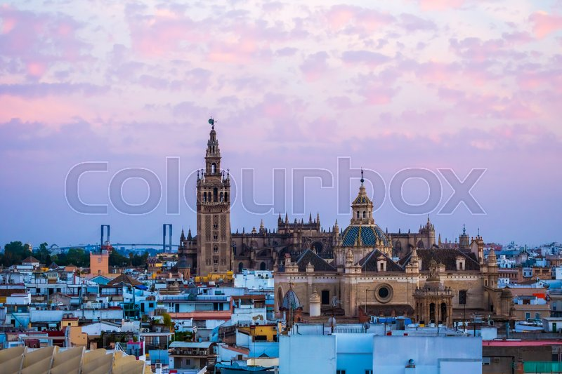 Stock image of 'Sunset in Seville, view from Metropol Parasol at the old Cathedral, Seville,Spain'