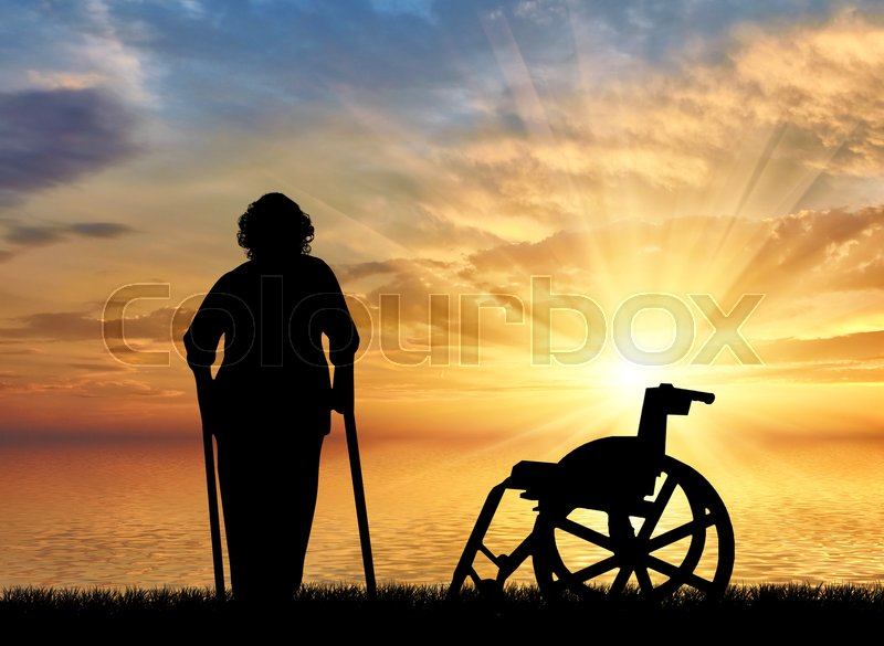 Stock image of 'Silhouette of an old woman on crutches on a background of sea sunset and wheelchair. Concept of disability and old age'