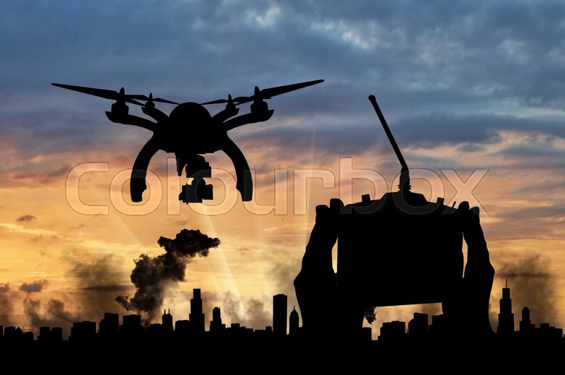 Stock image of 'Silhouette flying drones over city in smoke and hand remote control. Concept of military intelligence and information'