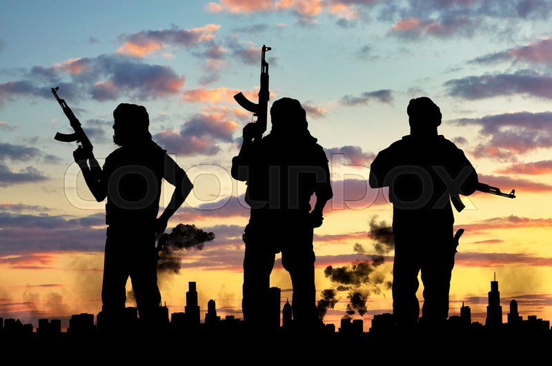 Stock image of 'Silhouette of a soldier with a gun against the sky'